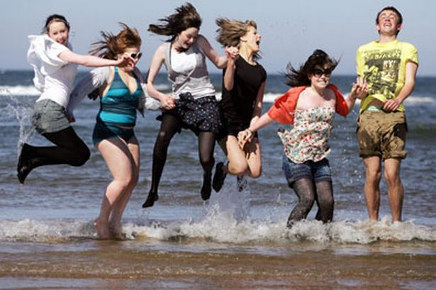 People jumping because a photographer has asked them to