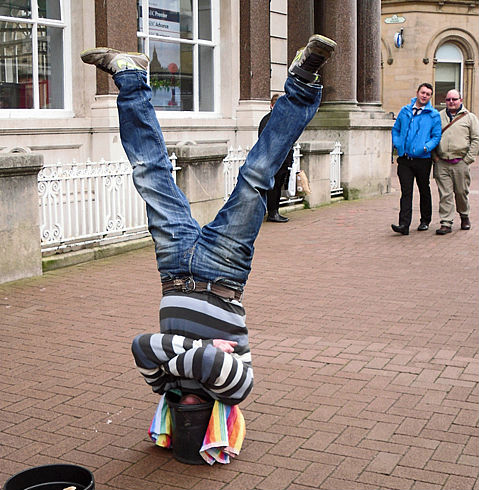 Man standing on head